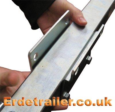 Position clamp bracket along the drawbar