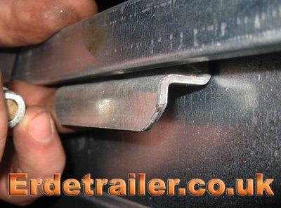Erde hard-top reinforcement plate in position