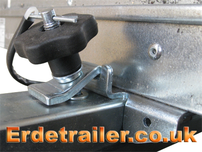A latch on the drawbar secures the tipping bracket.